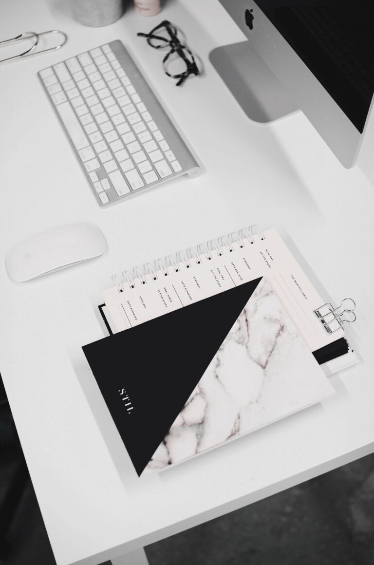 Journal, calendar and planner alongside computer for SecretarHe