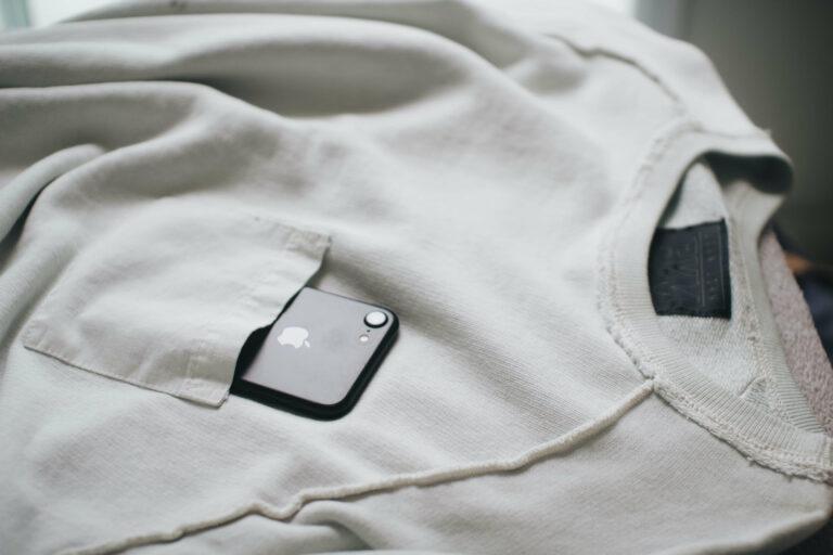 A phone in a sweater for SecretarHe